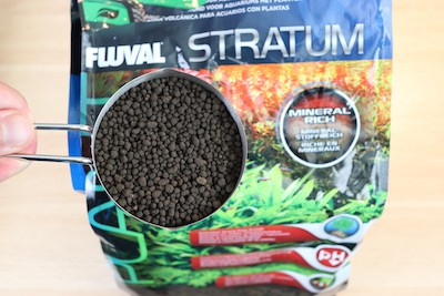 Fluval Stratum aquarium substrate for planted tanks and shrimp tanks. Fluval Stratum pellets are oval and mostly uniform in shape and size.