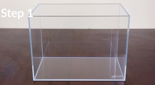 Rimless tank on wooden table.