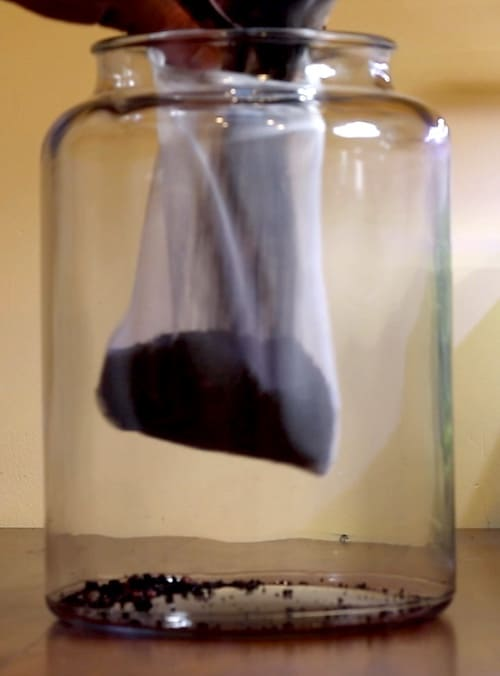Mesh filter bag filled with gravel for aquascaping.