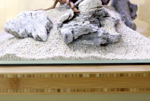Aquarium resting on solid table.
